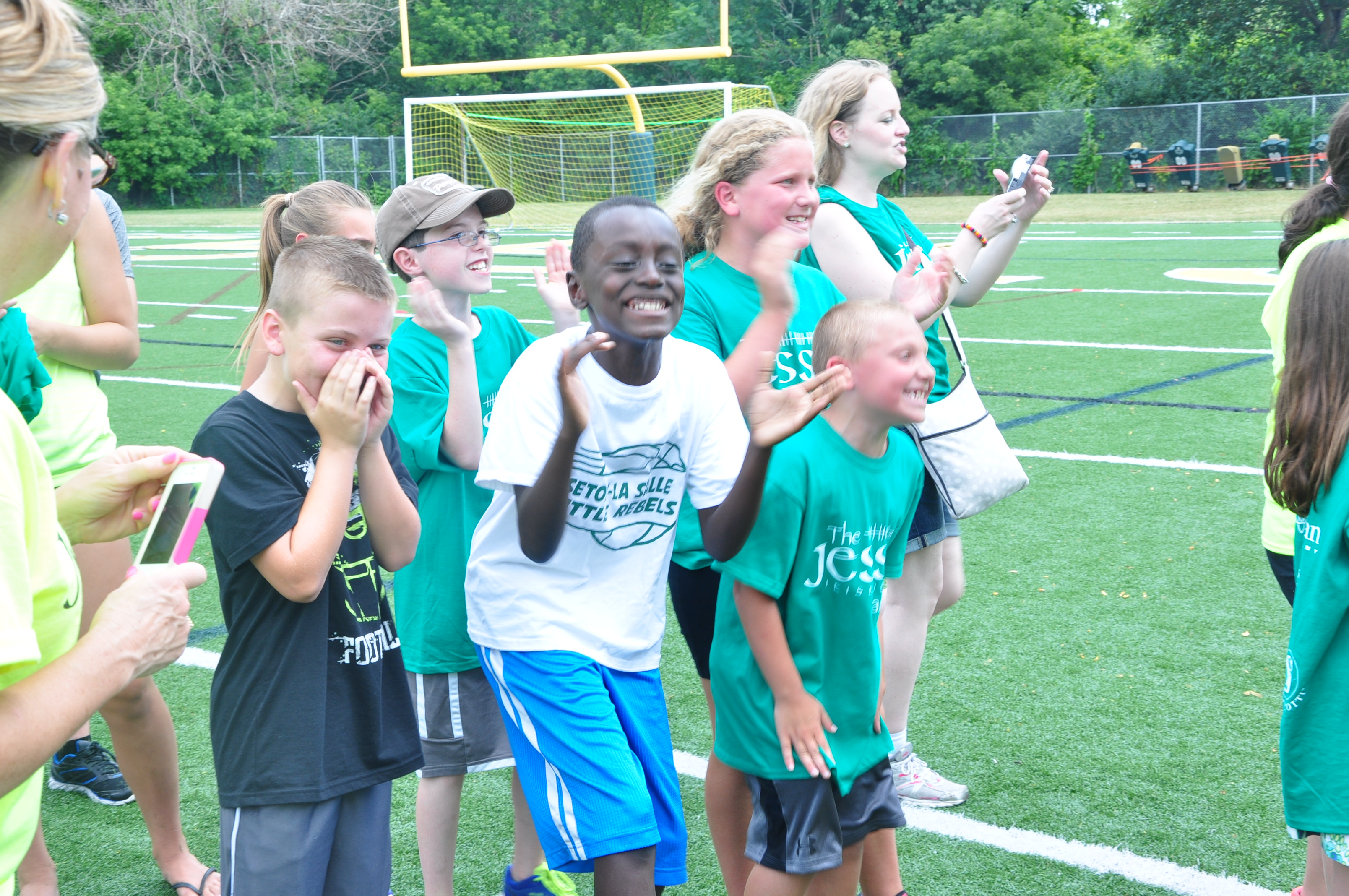 Cheering runners on at the 2014 Jessie Games