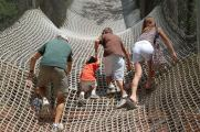 Dad, Eli, Peter, and Jessie climbing net