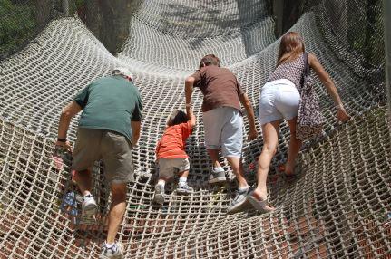 Dad, Eli, Peter, and Jessie climbing net