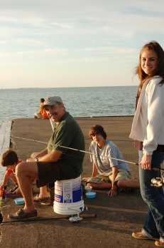 Jessie, her brothers and dad, fishing at family vacation spot, Lakeside, Ohio.